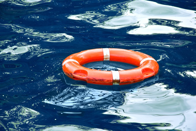 Red lifebuoy in blue water. Safe concept.